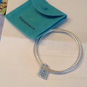 Tiffany & Co bangle bracelet with charm